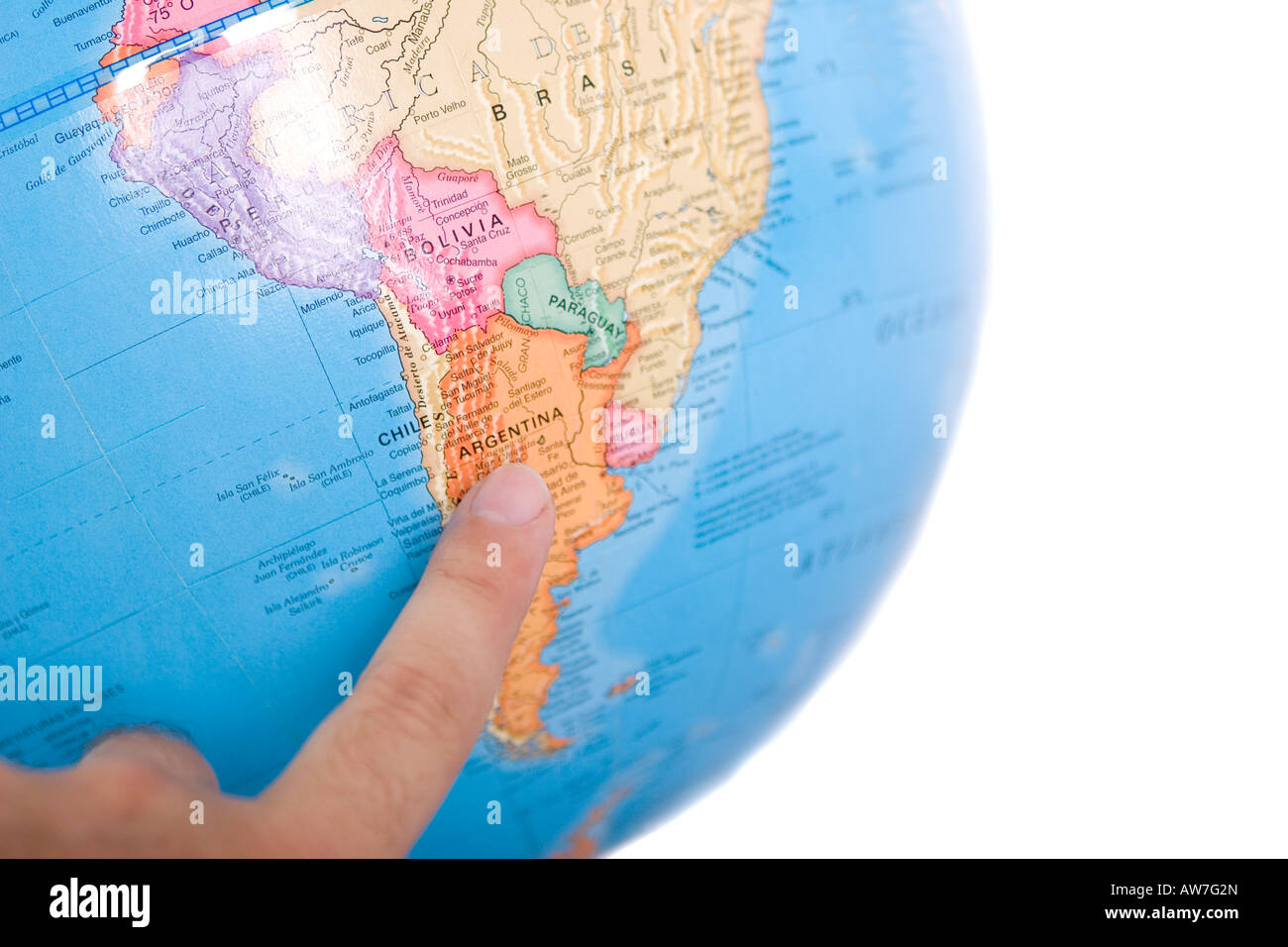 World map globe with a hand pointing Argentina Shallow depth of ...