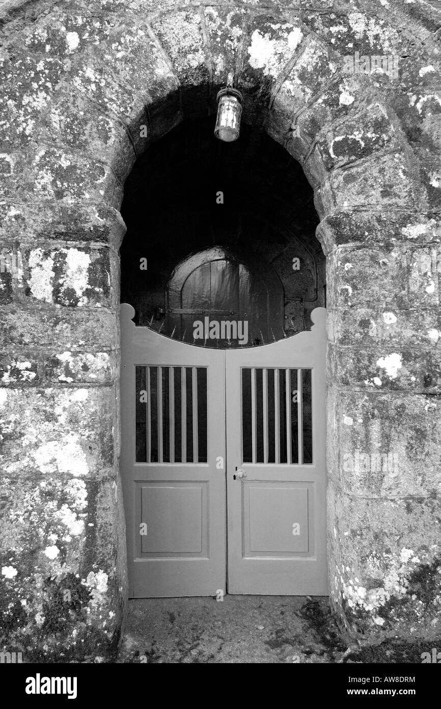 Main entrance of Holy Trinity Church at Gidleigh on Dartmoor National Park South Devon England in monochrome - Stock Image