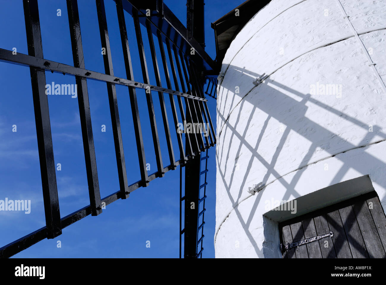 Windmill with blue sky behind - Stock Image