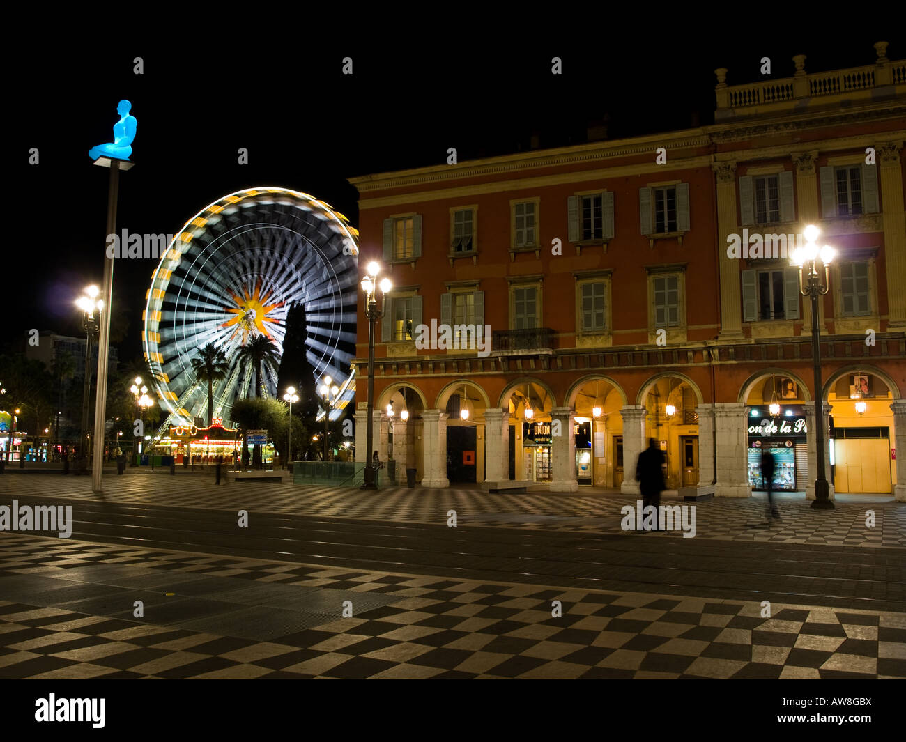 Colours light up Place Masséna in Nice, France at night. - Stock Image
