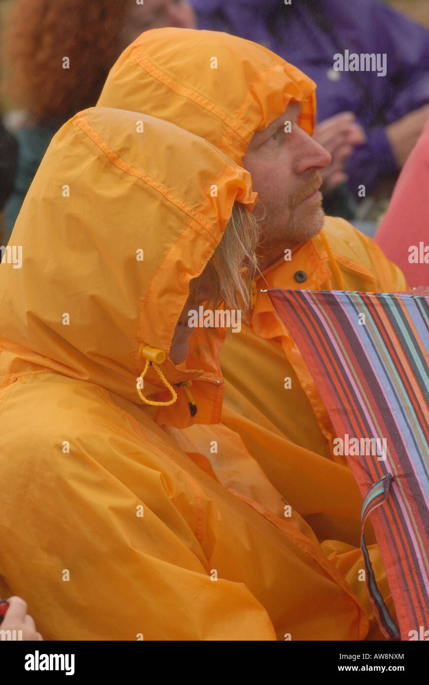 a man and a woman male and female husband and wife two people wearing pac-a-mac rain coats waterproof garments in - Stock Image