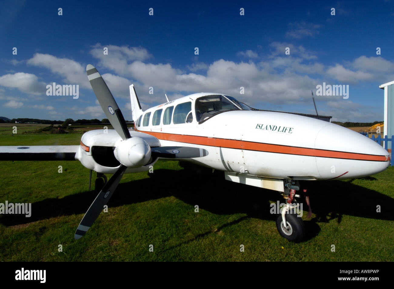 a light aircraft private plane jet propeller turbo prop aeroplane at an airfield airport aerodrome at sandown  the - Stock Image