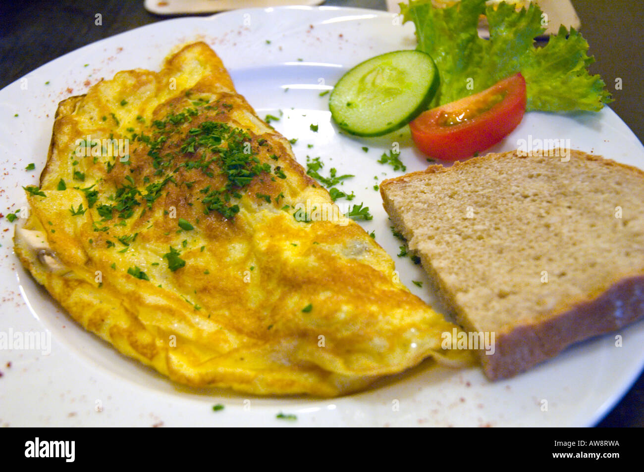 An omelet in a traditional Czech pub in old town of Prague the capital of Czech republic - Stock Image