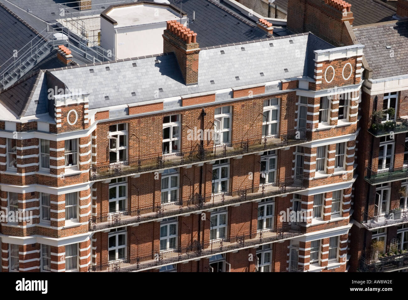 Aerial View Of Brick Victorian Apartment Building In Victoria London UK,  Showing Facade, Chimneys And Balconies