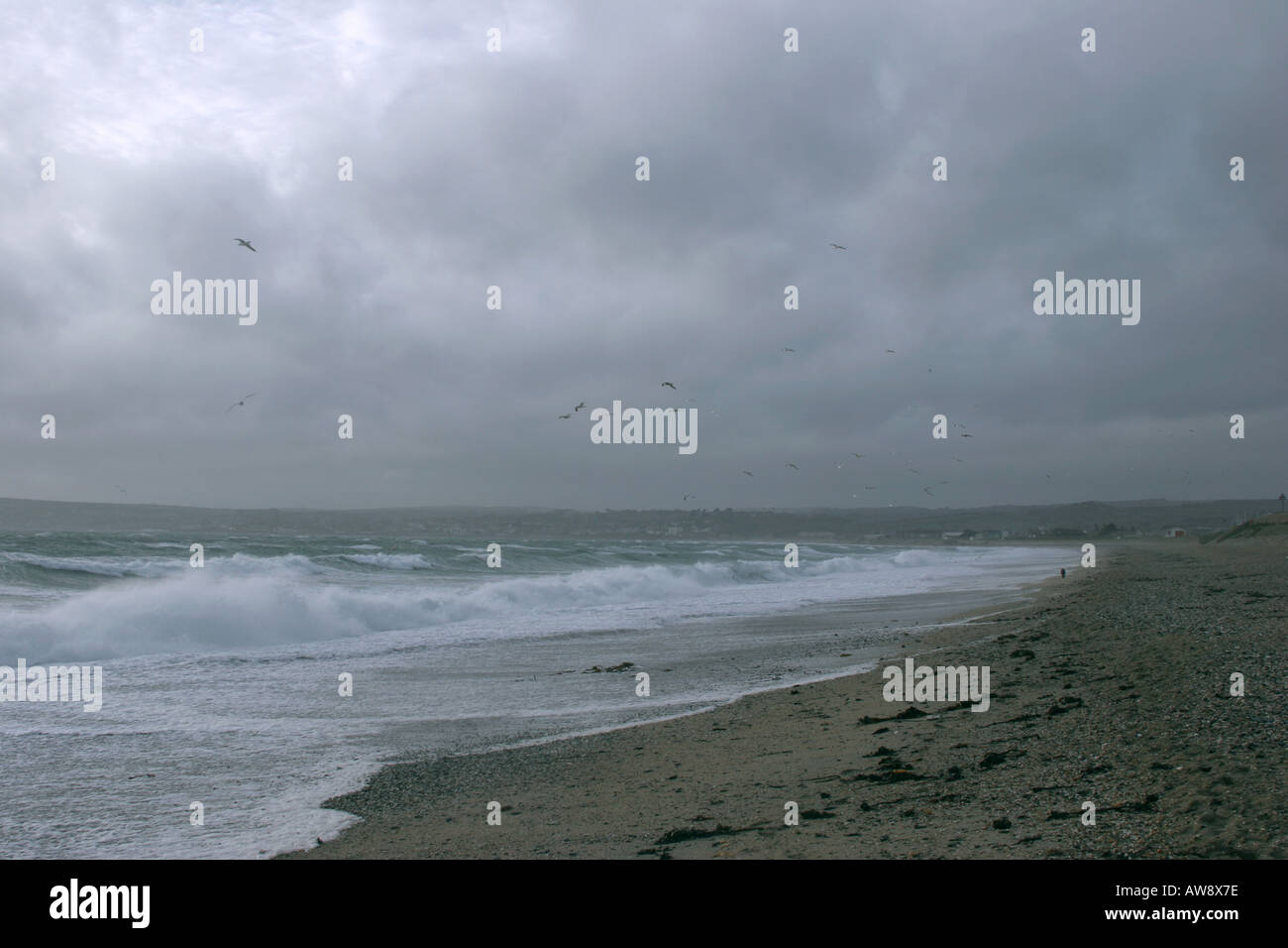 Dark day on the coast of Cornwall near Marazion with large waves - Stock Image