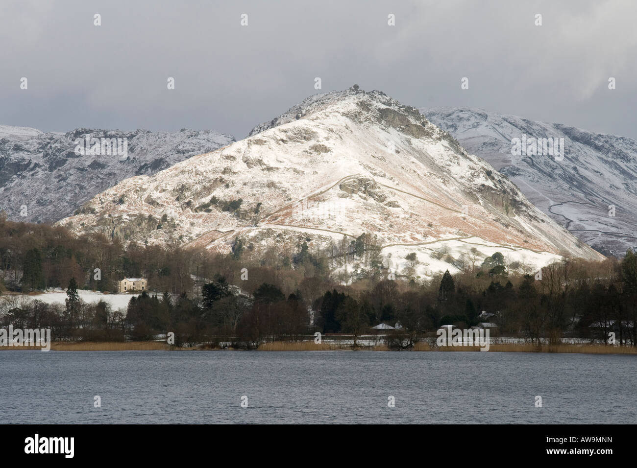 Snow dusted Helm Crag overlooking Grasmere Lake District Cumbria - Stock Image