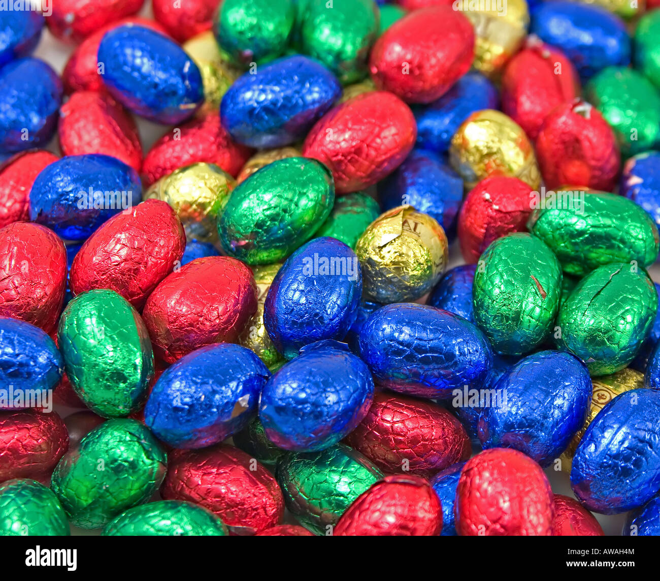 a large pile of colourful easter eggs - Stock Image