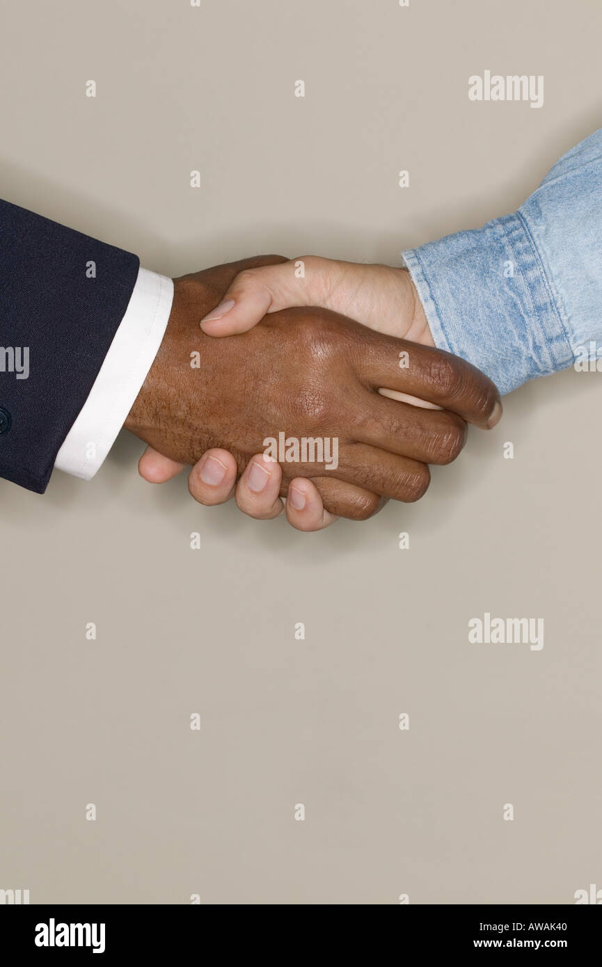 Two men shaking hands - Stock Image