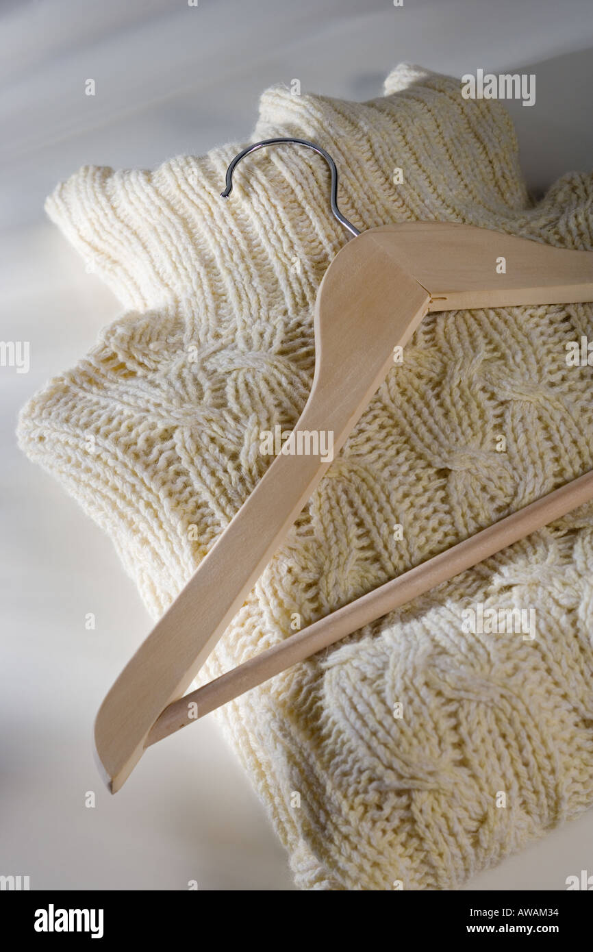 Folded sweater with hanger - Stock Image