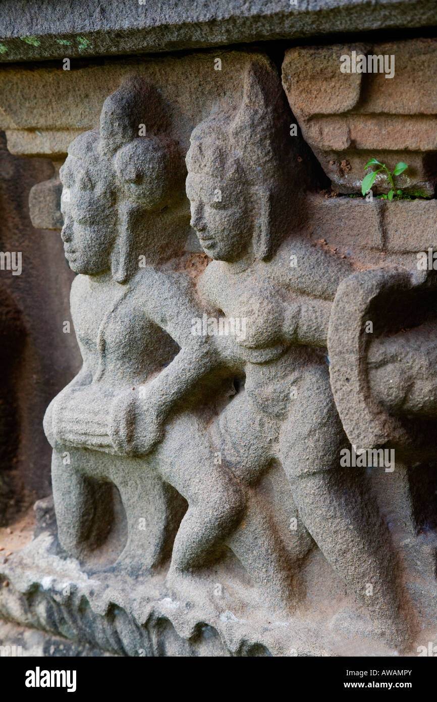 Ancient CHAM STONE CARVINGS of musicians decorate the stone foundations of the temples at the CHIEN DANG RUINS TAM - Stock Image