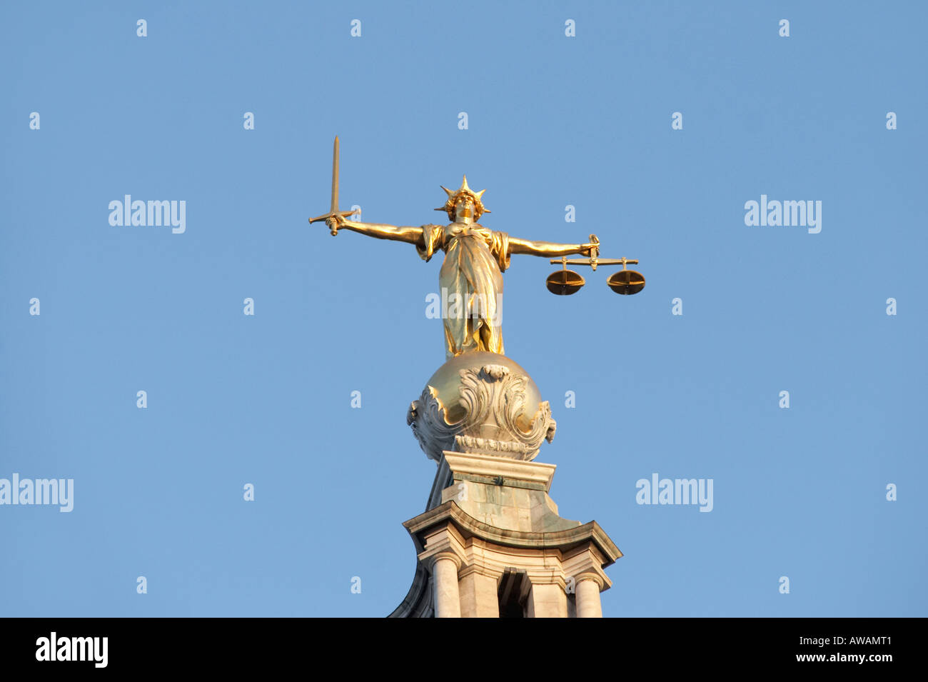Scales of Justice statue at The Old Bailey in London UK - Stock Image