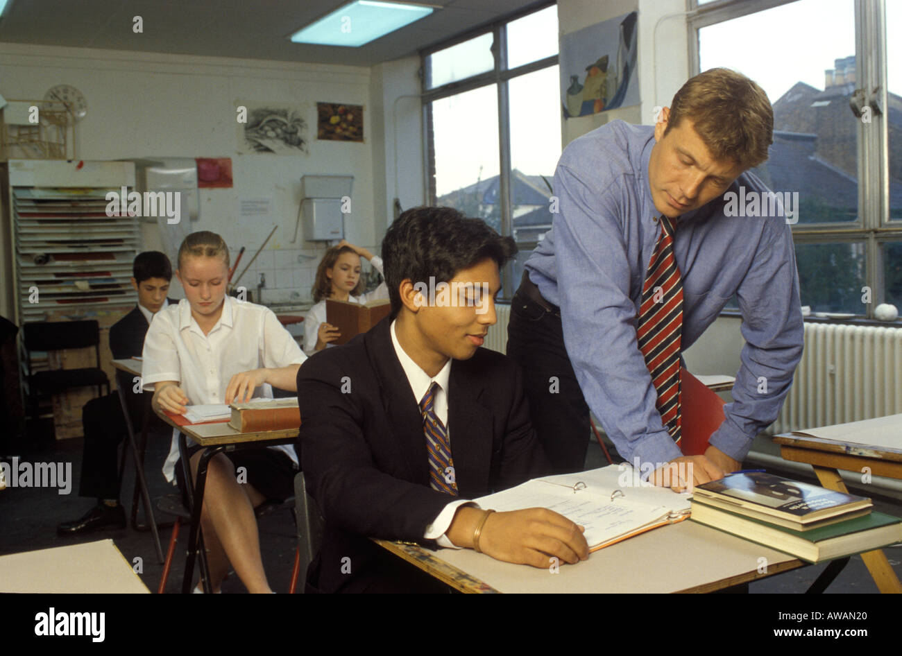 teacher talking to male pupil in class stock photo 5393695 alamy