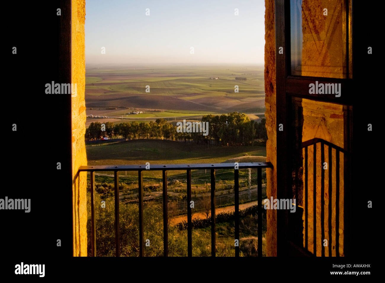 Agricultural land in the valley of Carmona Spain in the province of Seville is framed by a window - Stock Image