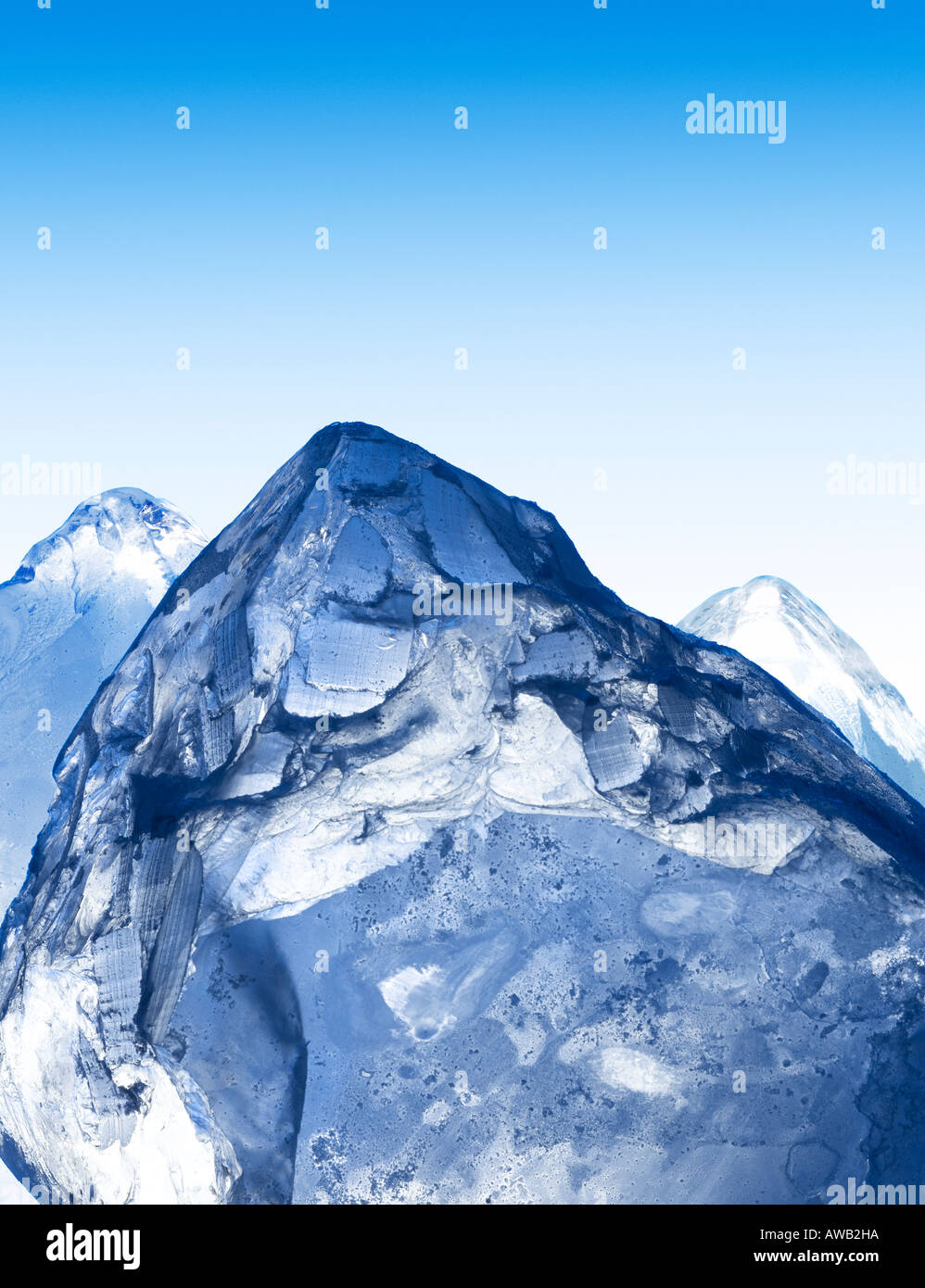 A group of ice cubes cleverly positioned to look like the peaks of some mountains. - Stock Image