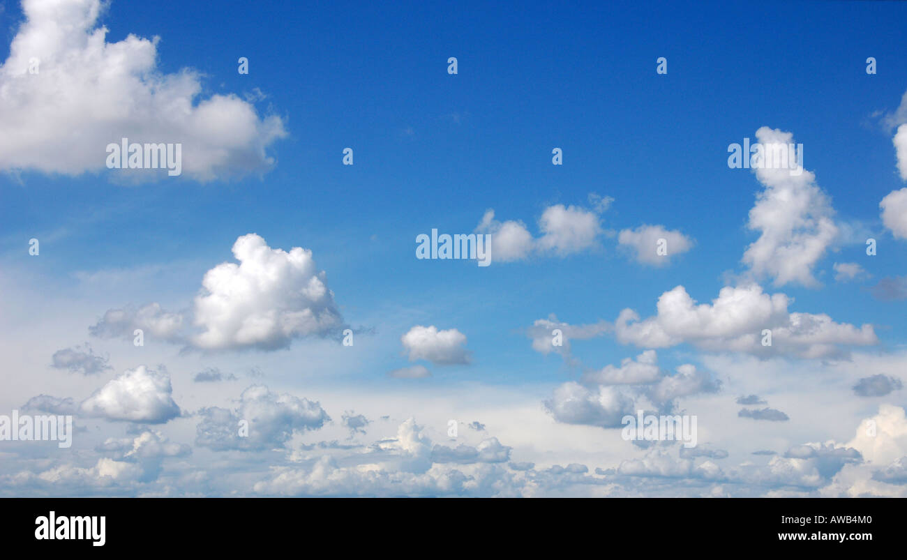 blue sky with cumulous clouds - Stock Image