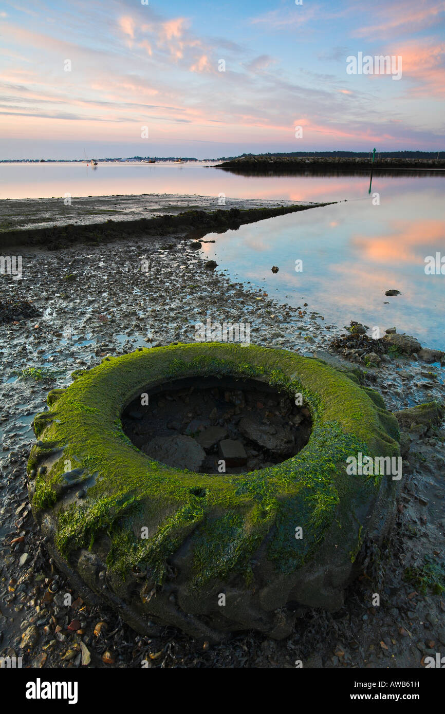 Discarded tractor tyre reappears in the low tide at Poole Quay, Dorset - Stock Image