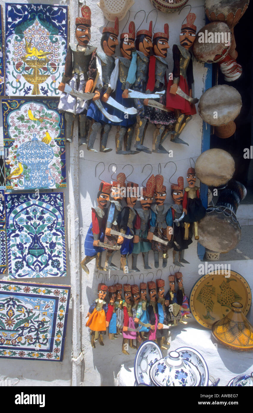 Souvenirs for sale in main shopping street of the picturesque, blue and white town,Sidi Bou Said in Tunisia - Stock Image