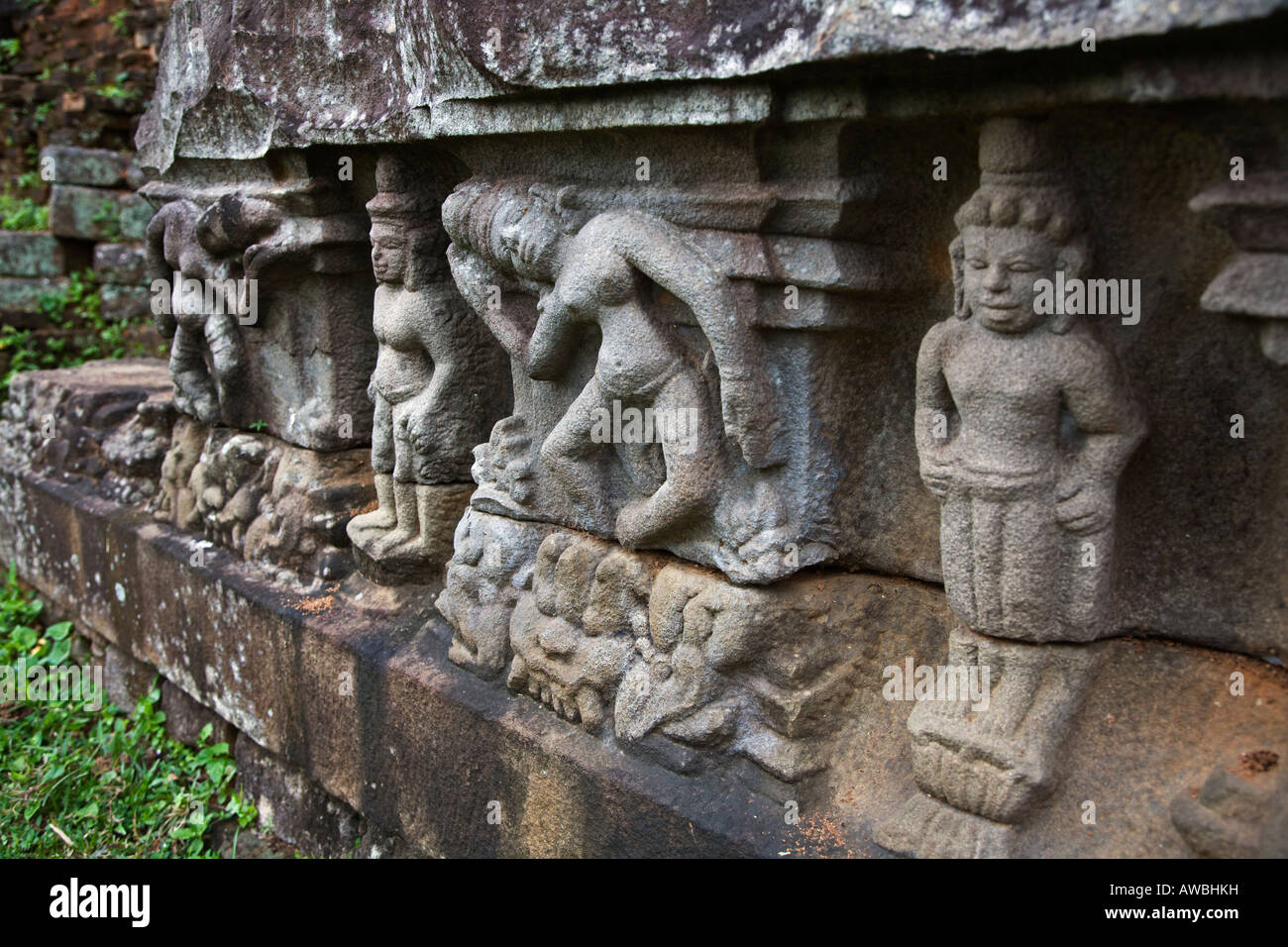 Ancient CHAM STONE CARVINGS decorate the foundations of the TEMPLES at the CHIEN DANG RUINS TAM KY VIETNAM - Stock Image