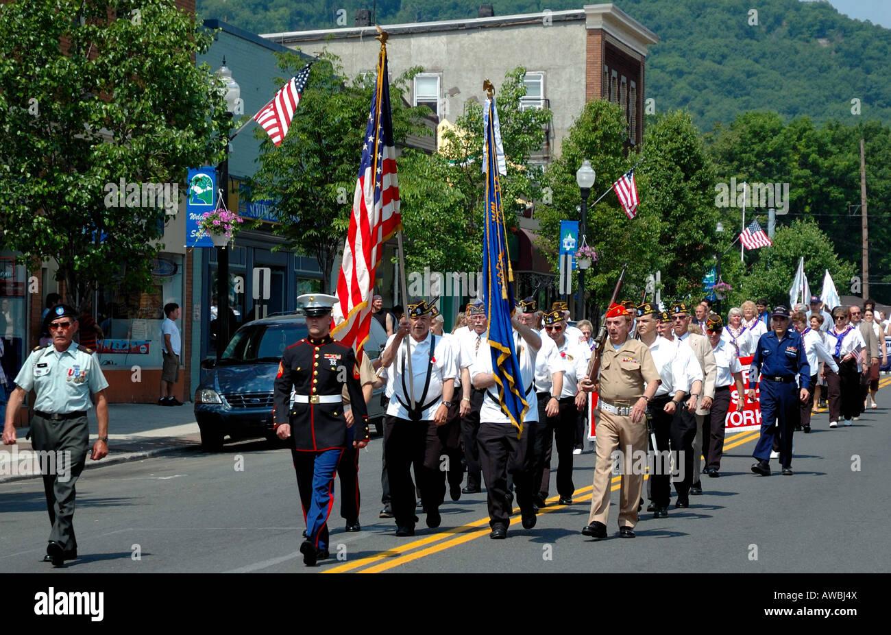 Small town Memorial Day parade Honor guard and veterans participate in a Memorial Day parade on Main Street Suffern - Stock Image