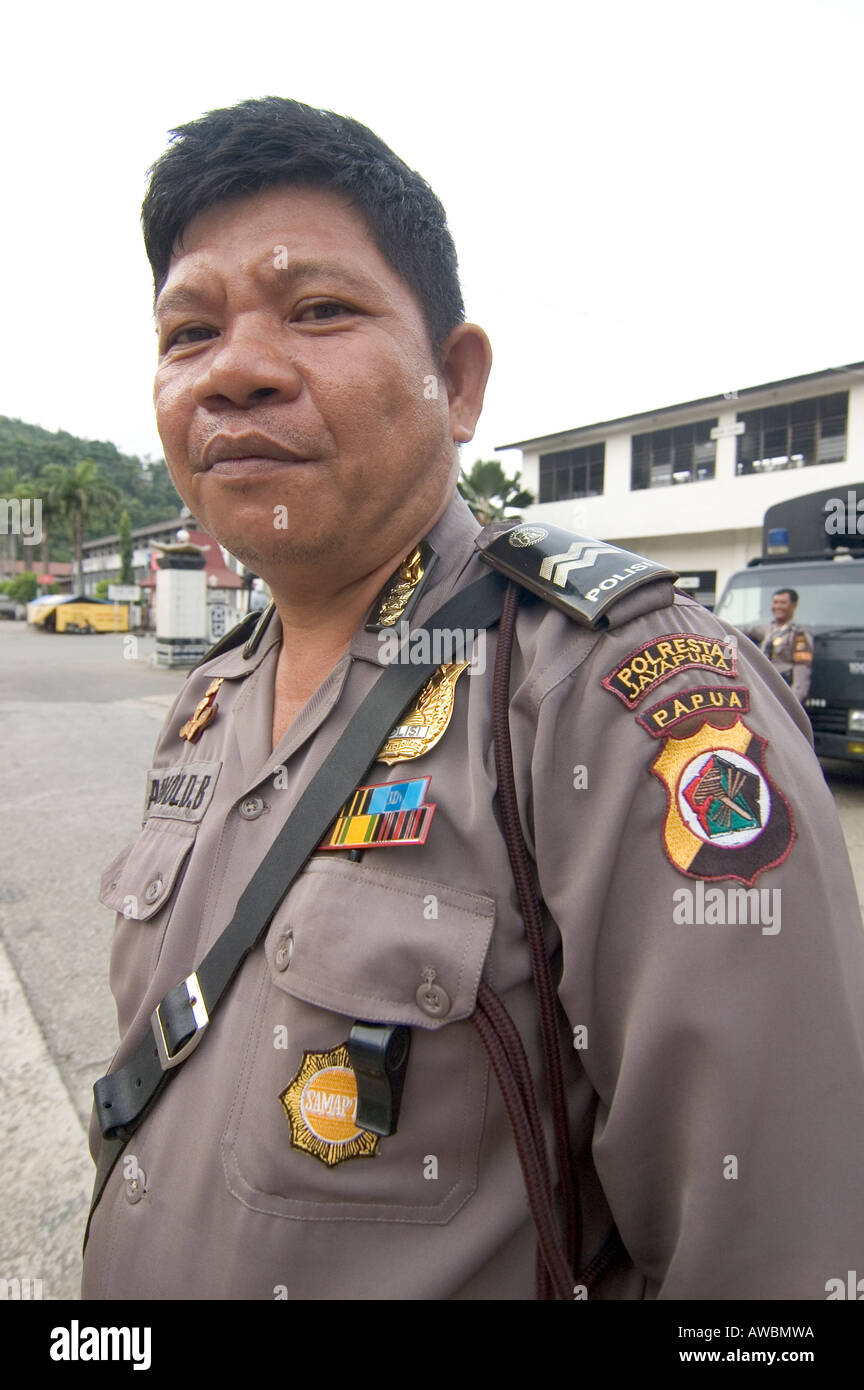 Portrait of an Indonesian police officer in Jayapura, with a West Papua insign on his shirt, West Papua, Indonesia Stock Photo