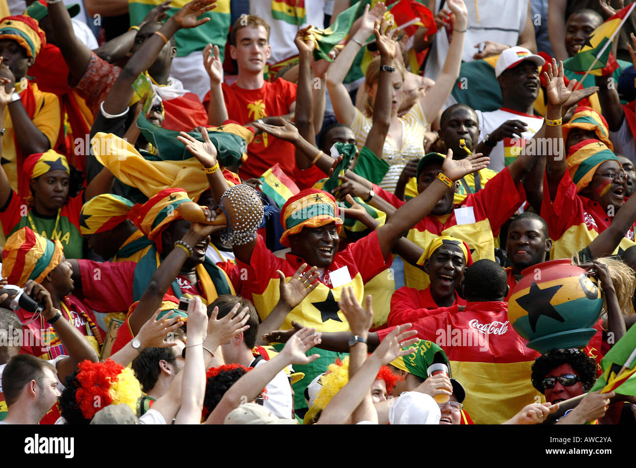 Ghanian fans singing in the crowd during the 2006 World Cup - Stock Image