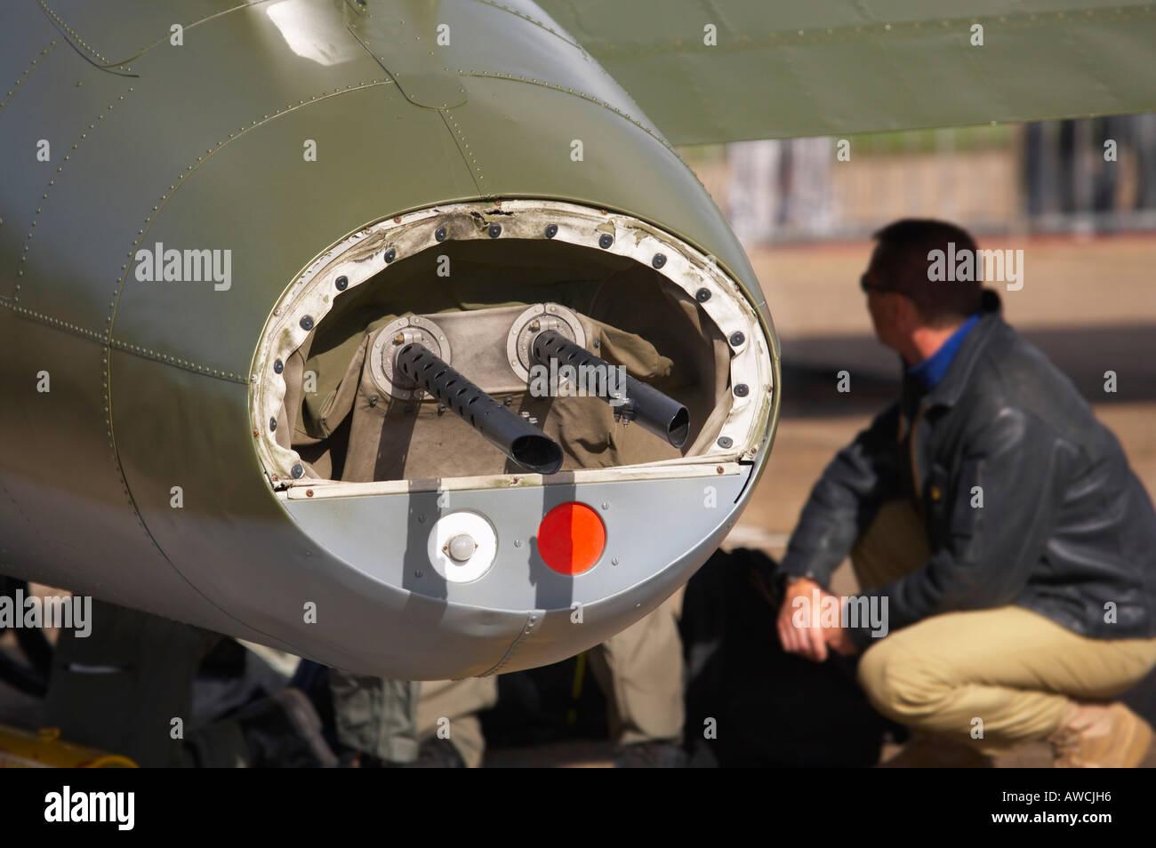Rear guns of B17 Flying Fortress Sally B at Duxford aerodrome UK with crew member - Stock Image