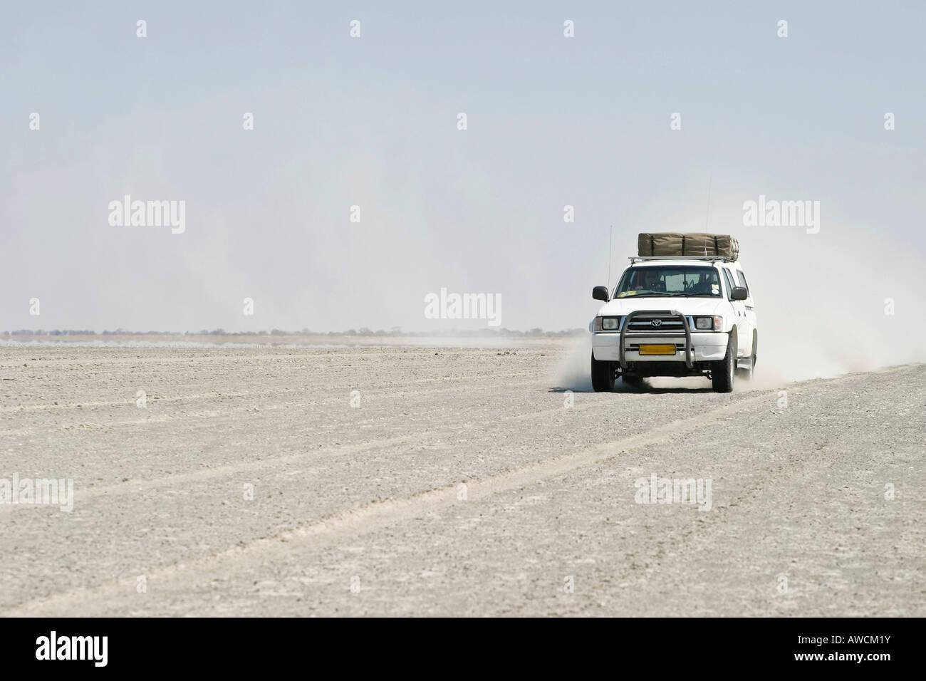 Offroad tour over a big salt pan, Sowa Pan, Makgadikgadi pans, Botswana, Africa - Stock Image