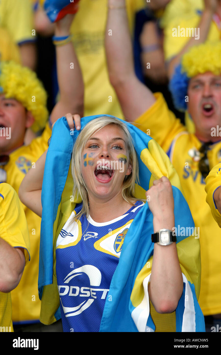 A female Swedish supporter singing in the crowd during the 2006 World Cup - Stock Image