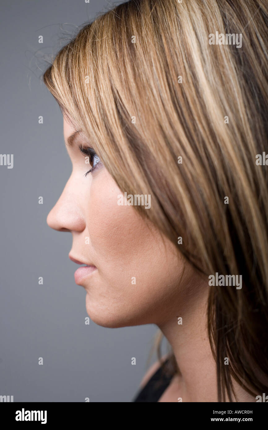 Profile of young woman looking to the left - Stock Image