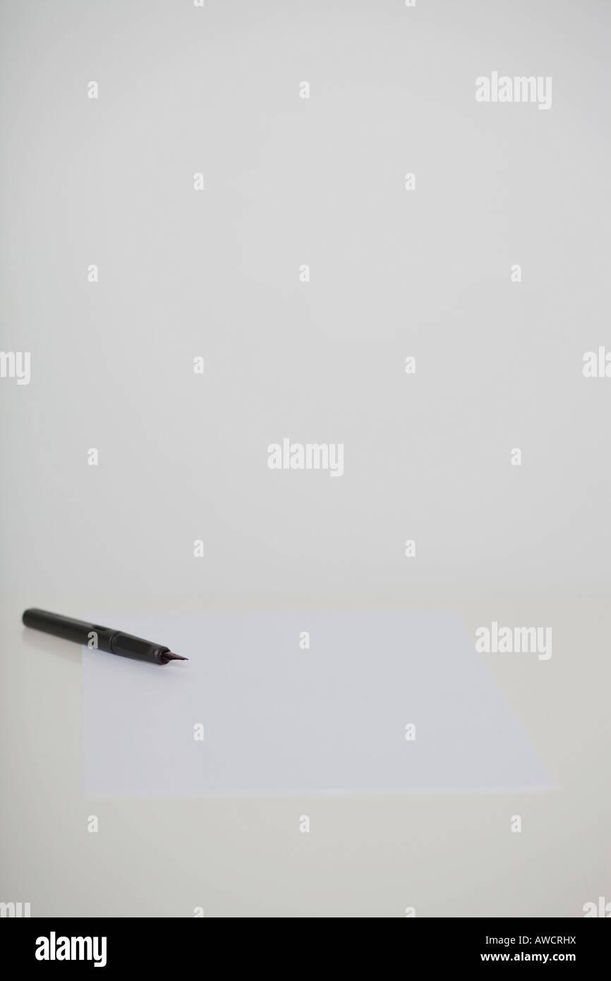 Fountain pen on a white paper sheet Stock Photo
