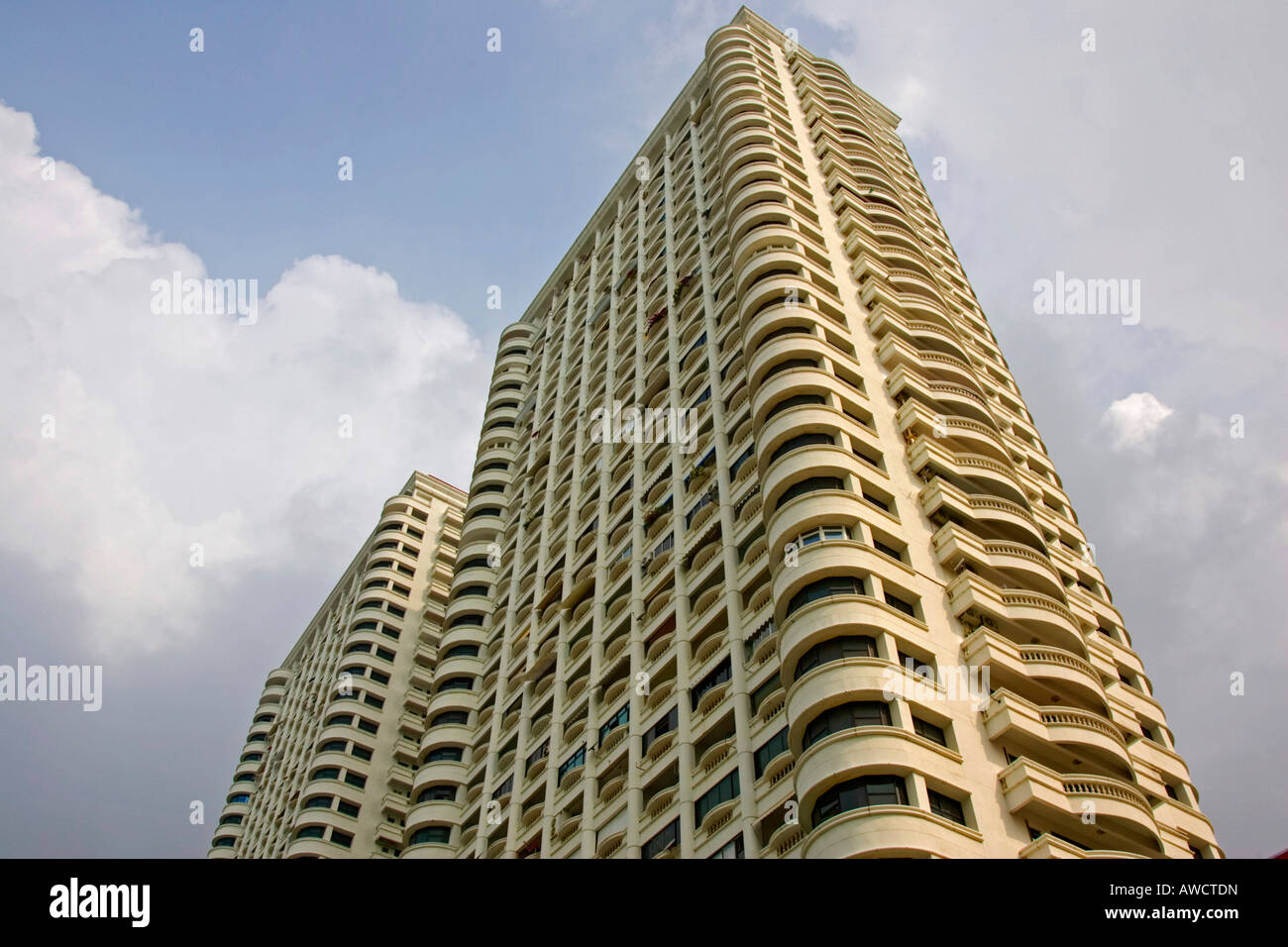 Typical apartment building where flats are rented by the week or month or sold as condos in Pattaya, Thailand, Southeast - Stock Image