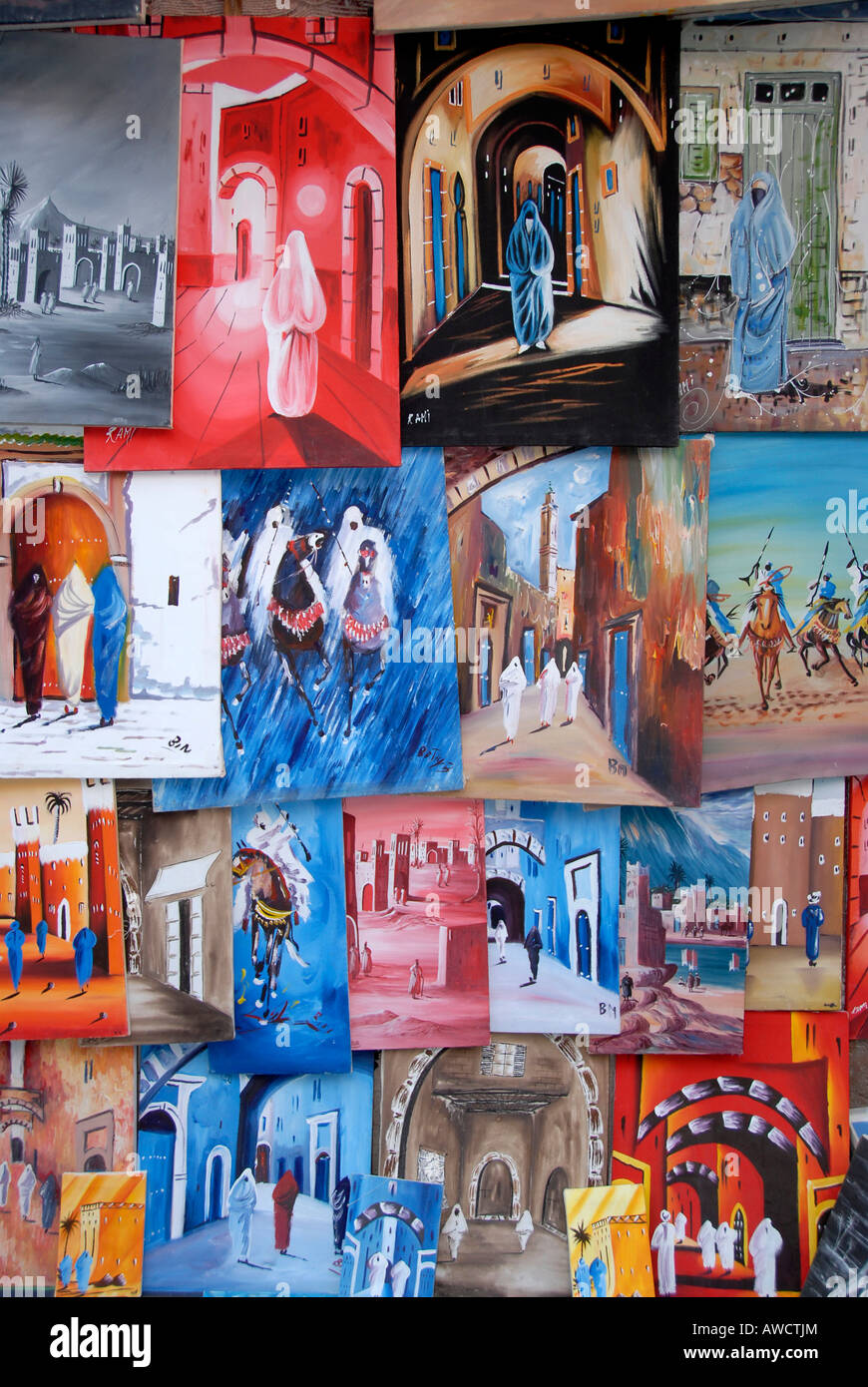 Compilation of many colourful paintings in the medina Marrakech Morocco - Stock Image