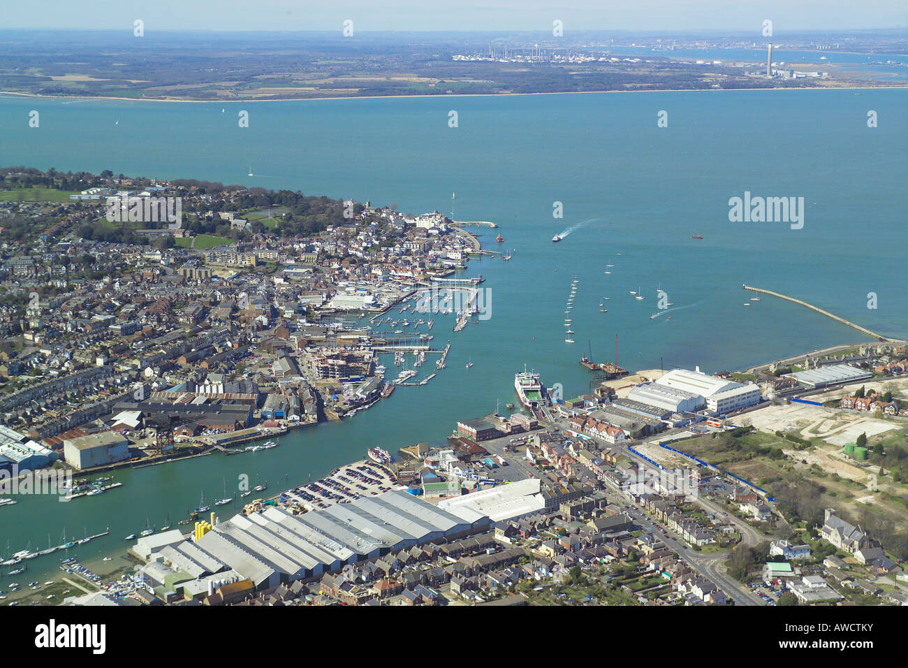 Panoramic aerial view of Cowes & East Cowes on the Isle of Wight featuring the ferry terminal, boat yards & the Stock Photo