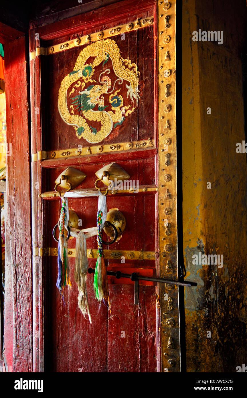 Painted door, Palcho Monastery or Pelkor Chode Monastery or Shekar Gyantse, Gyantse, Tibet - Stock Image