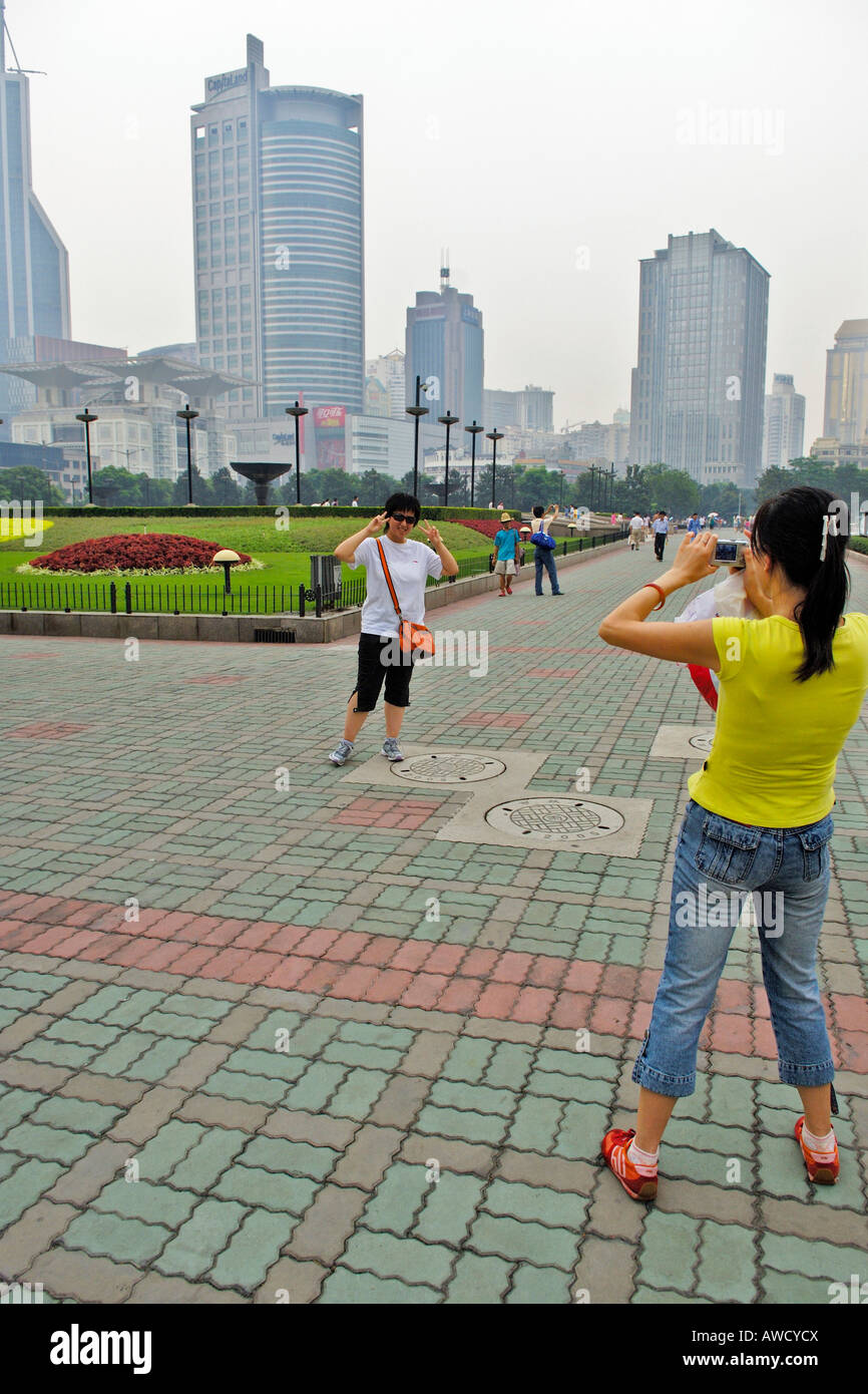 Public park, skyscrapers, chinese take some photos, Shanghai, China, Asia - Stock Image