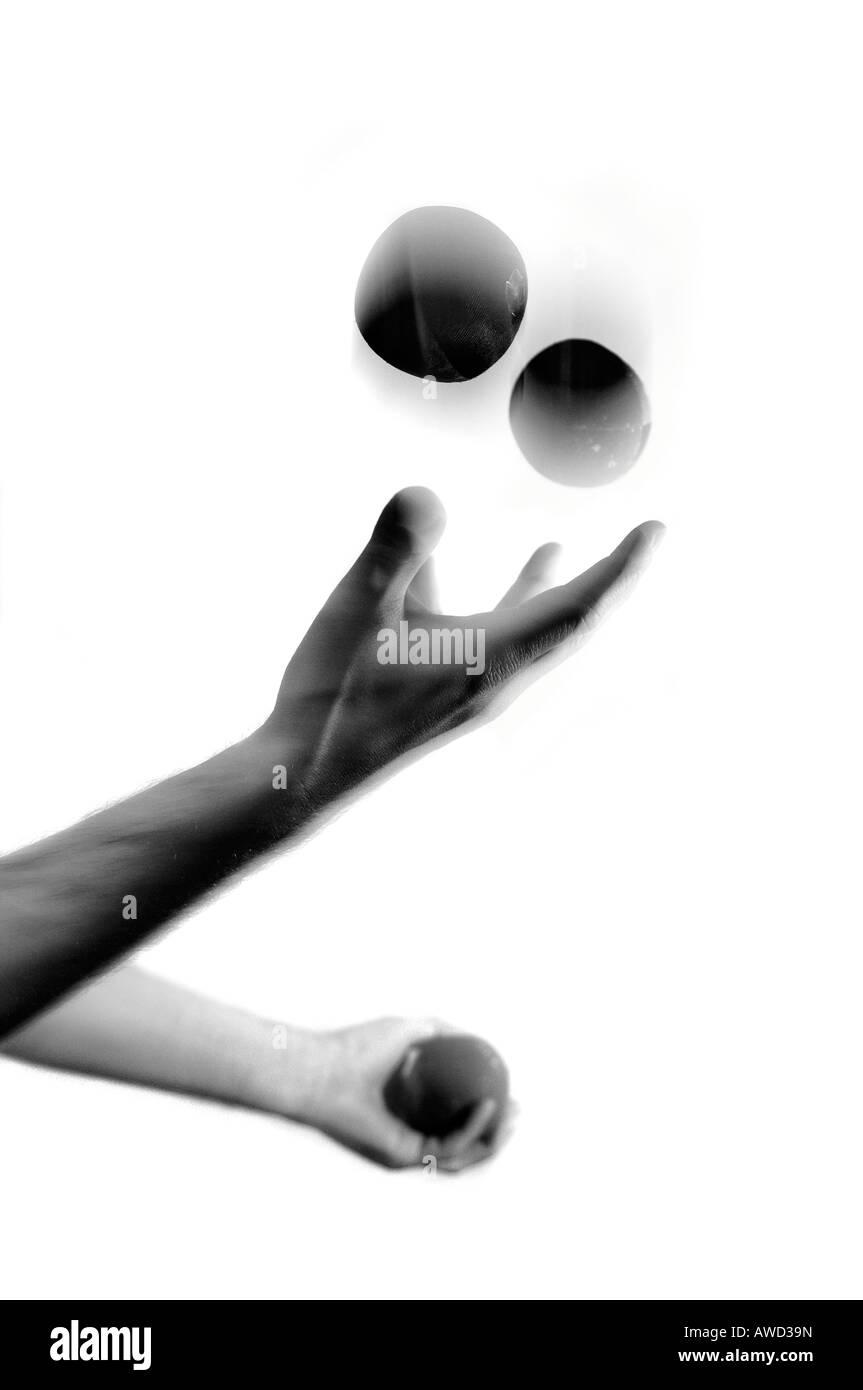 Hands juggling - Stock Image