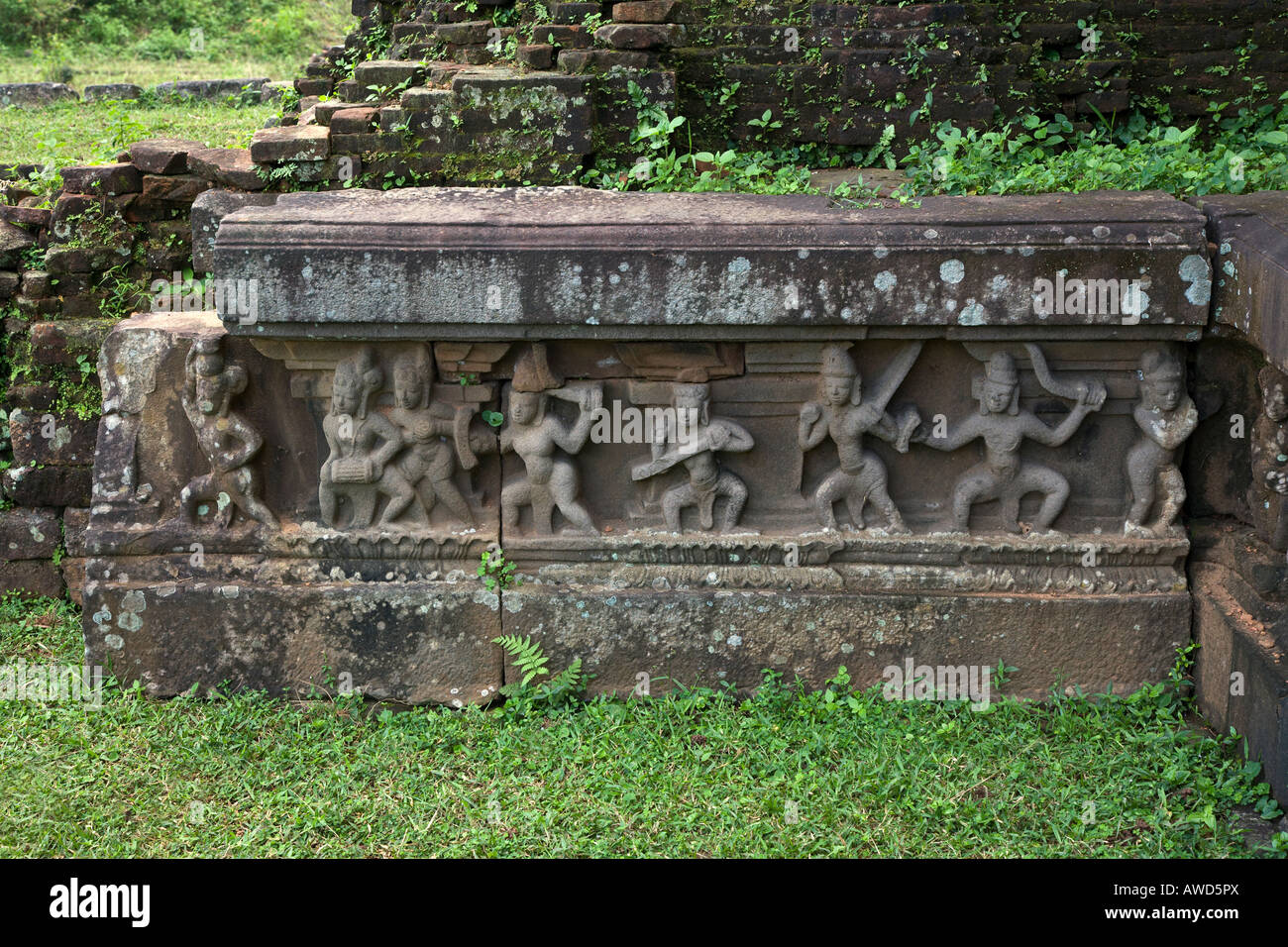 Ancient CHAM STONE CARVINGS decorate the surface of the stone foundations of the TEMPLES at the CHIEN DANG RUINS - Stock Image