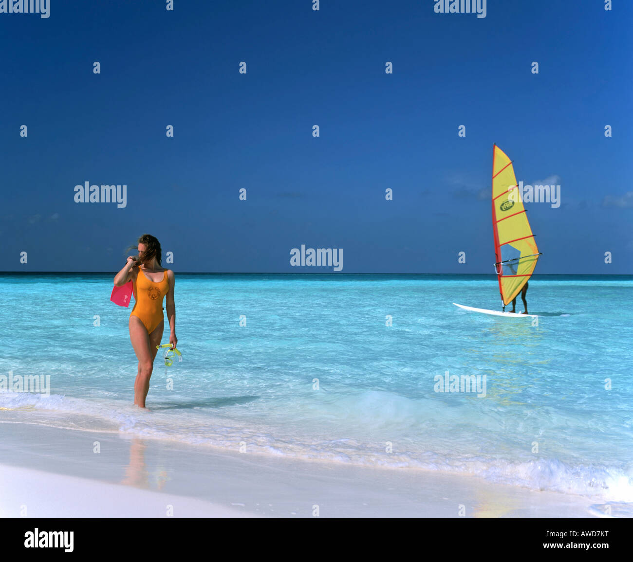 Young woman on the beach, windsurfer, Maldives, Indian Ocean Stock Photo