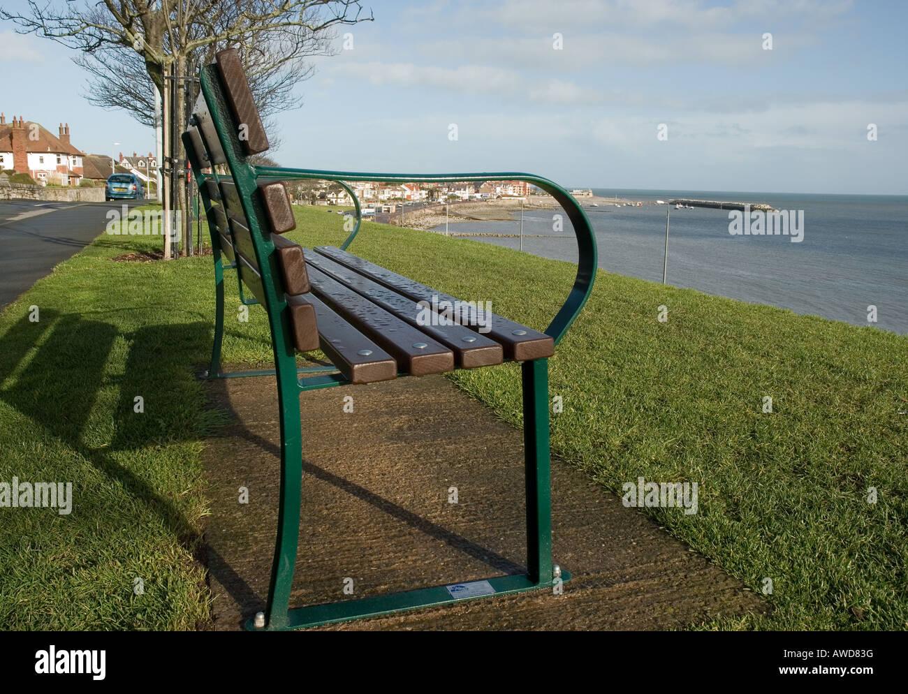 Park bench overlooking Colwyn Bay Promenade - Stock Image