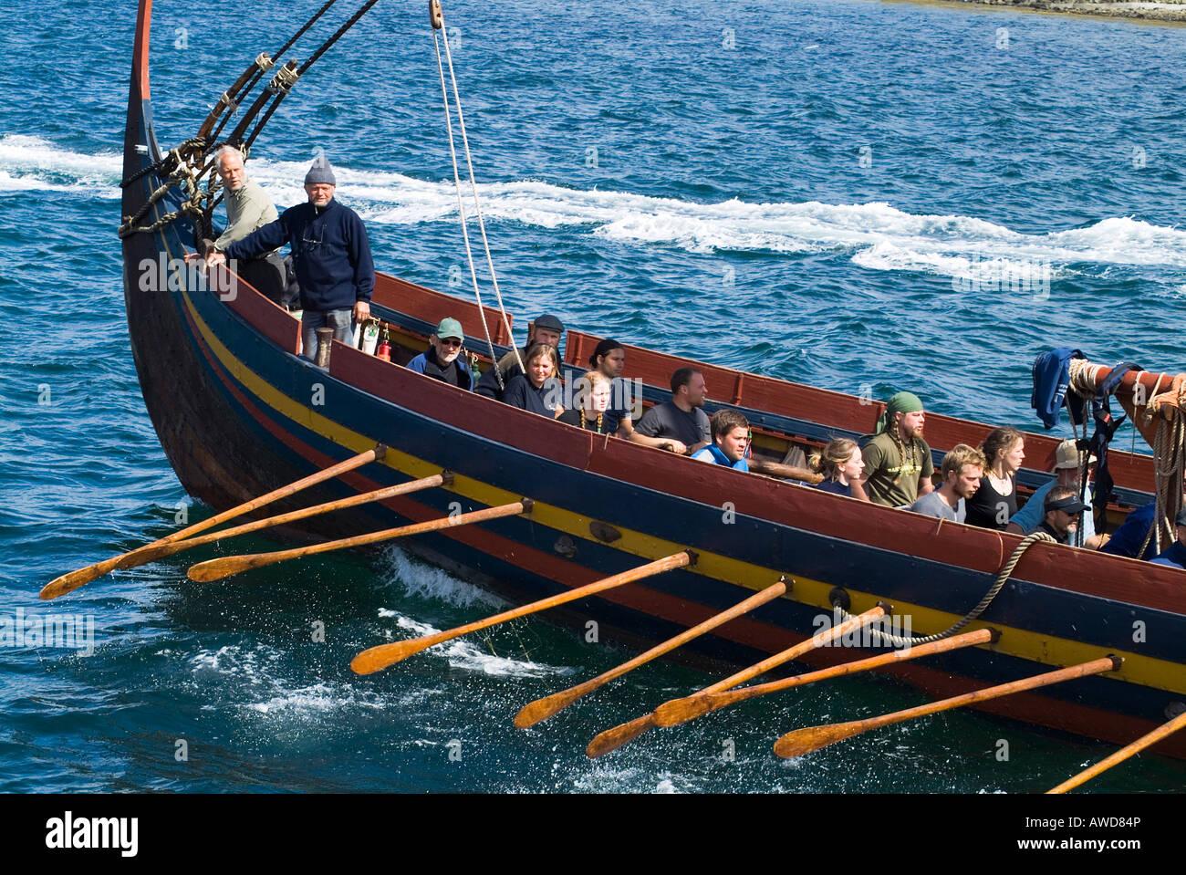 dh Sea Stallion KIRKWALL ORKNEY Sailors rowing viking Havhingsten fra Glendalough boat longship rowers oar - Stock Image