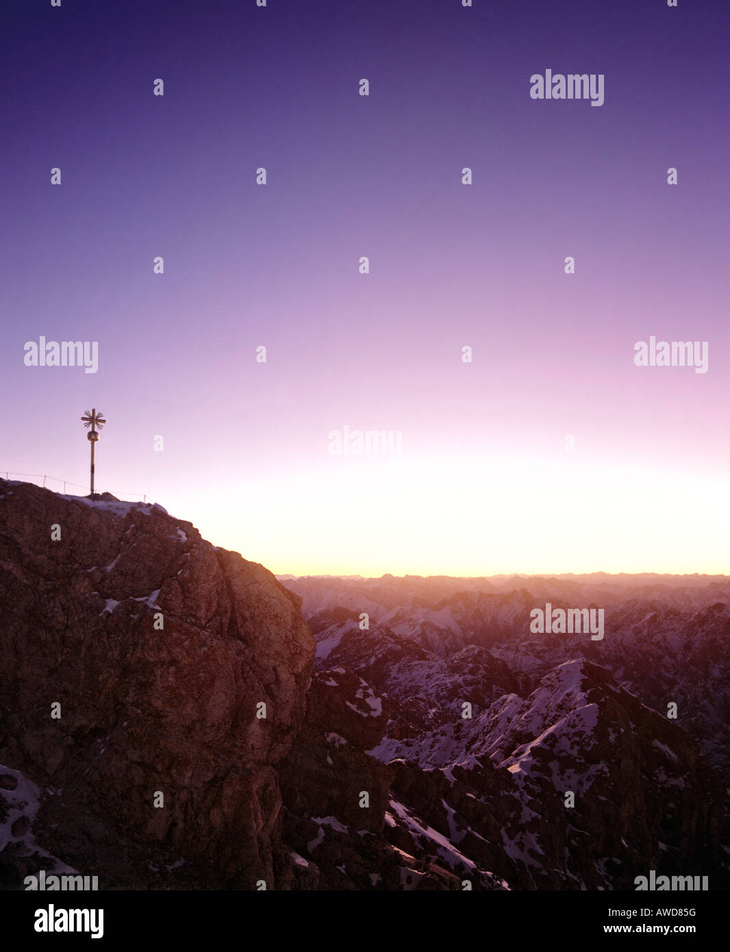 Summit cross at 2962 m or 9718 ft on the Zugspitze, Germany's highest mountain, at dawn, Wetterstein Range, - Stock Image