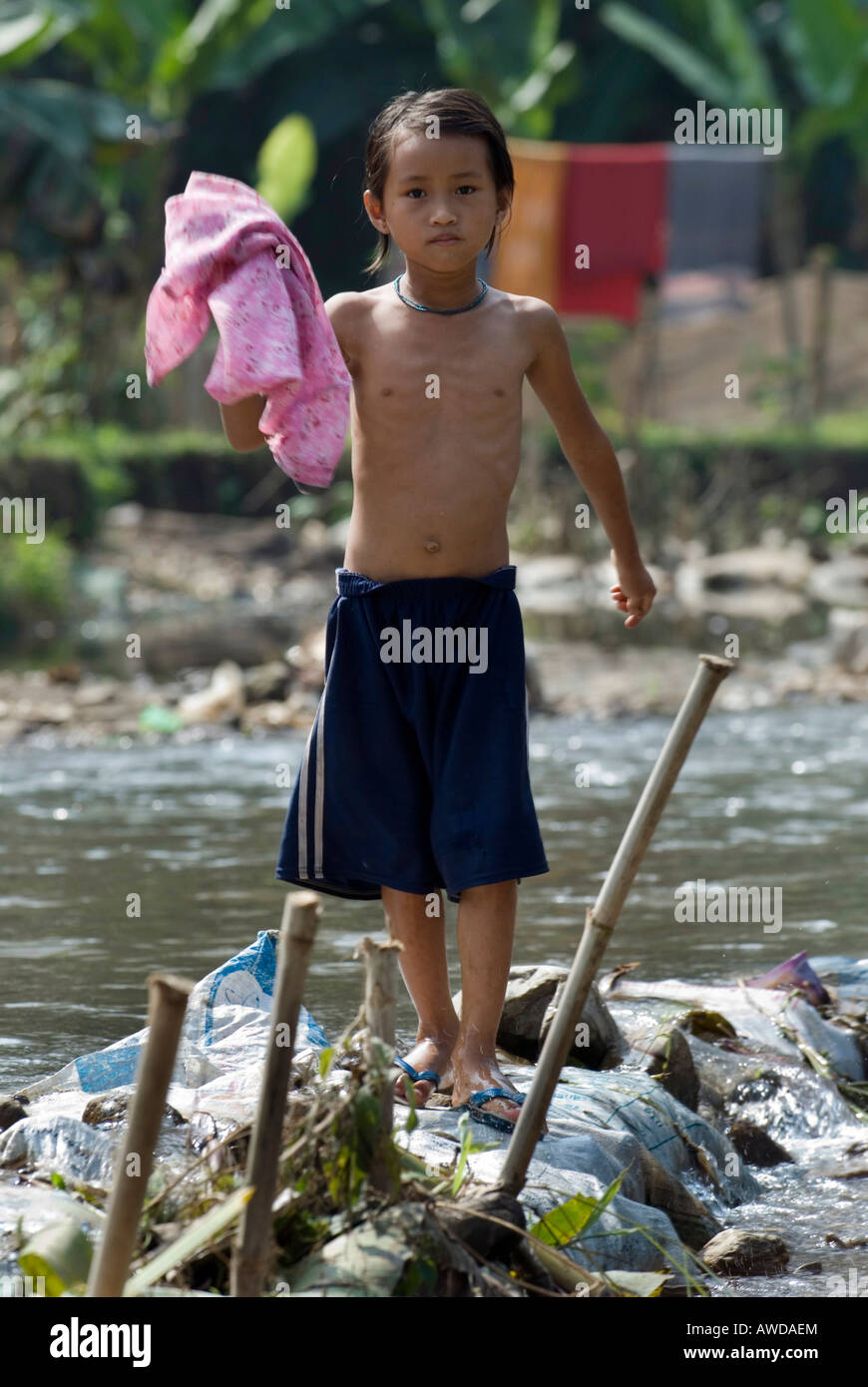 Girl at the river, Mae Ra Camp for Burmese refugees, Maesot, Thailand - Stock Image