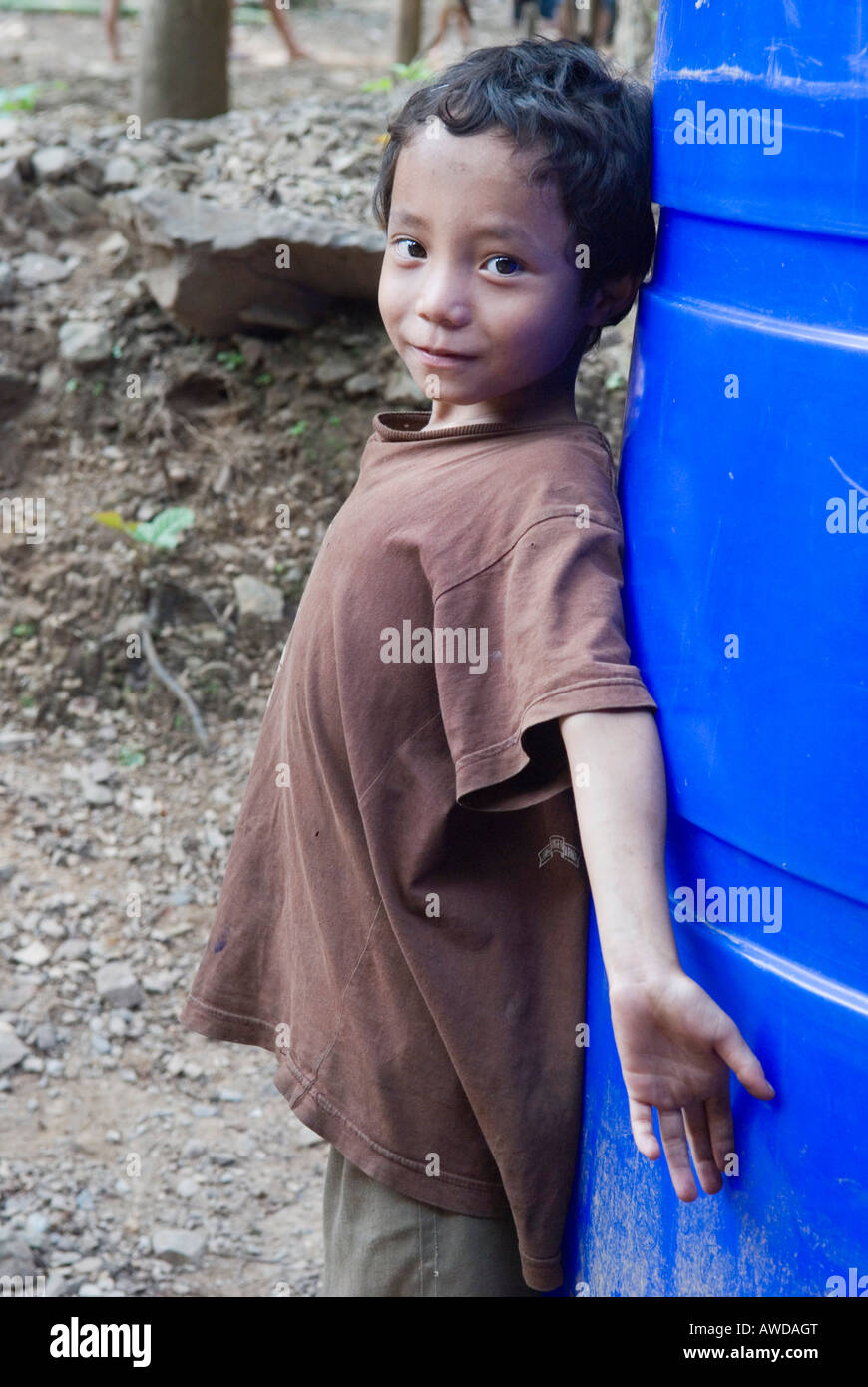 Portrait of a boy leaning at a water tank, refugee camp Oh Win Hta, IDP-Area bordering Thailand near Mae Sariang, - Stock Image