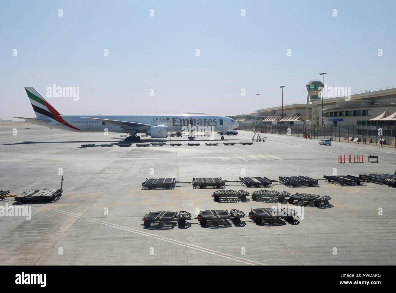 "Boeing 777-300 of the airline ""Emirates"" at Dubai International Airport, United Arab Emirates Stock Photo"