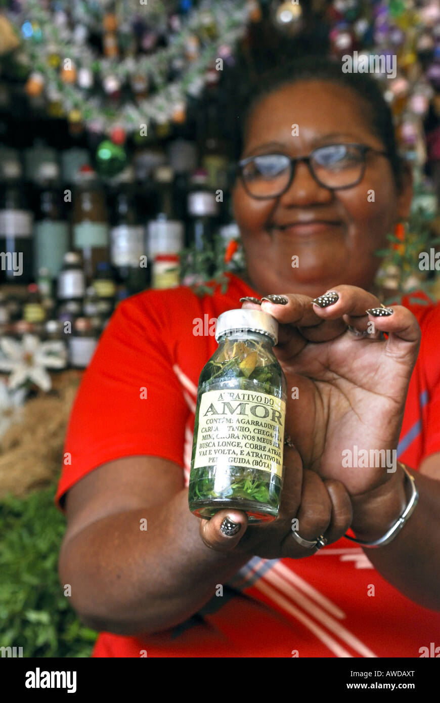 "Witch woman selling love essence made of products of the Amazon rainforest, ""Ver-O-Peso"" market, Belem, Para, Brazil Stock Photo"