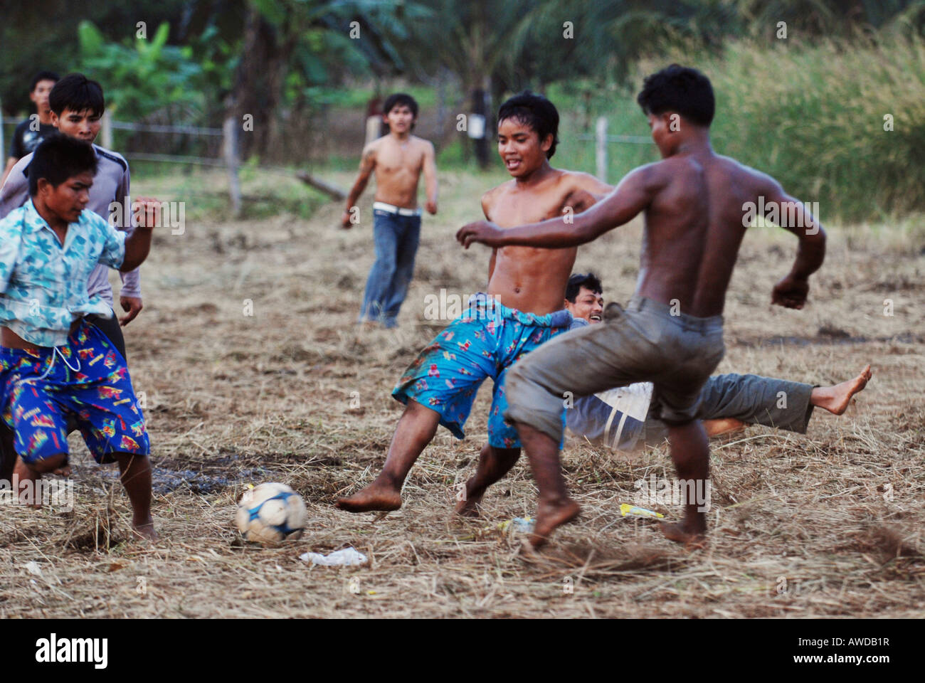 Boys playing football in rural Cambodia Stock Photo