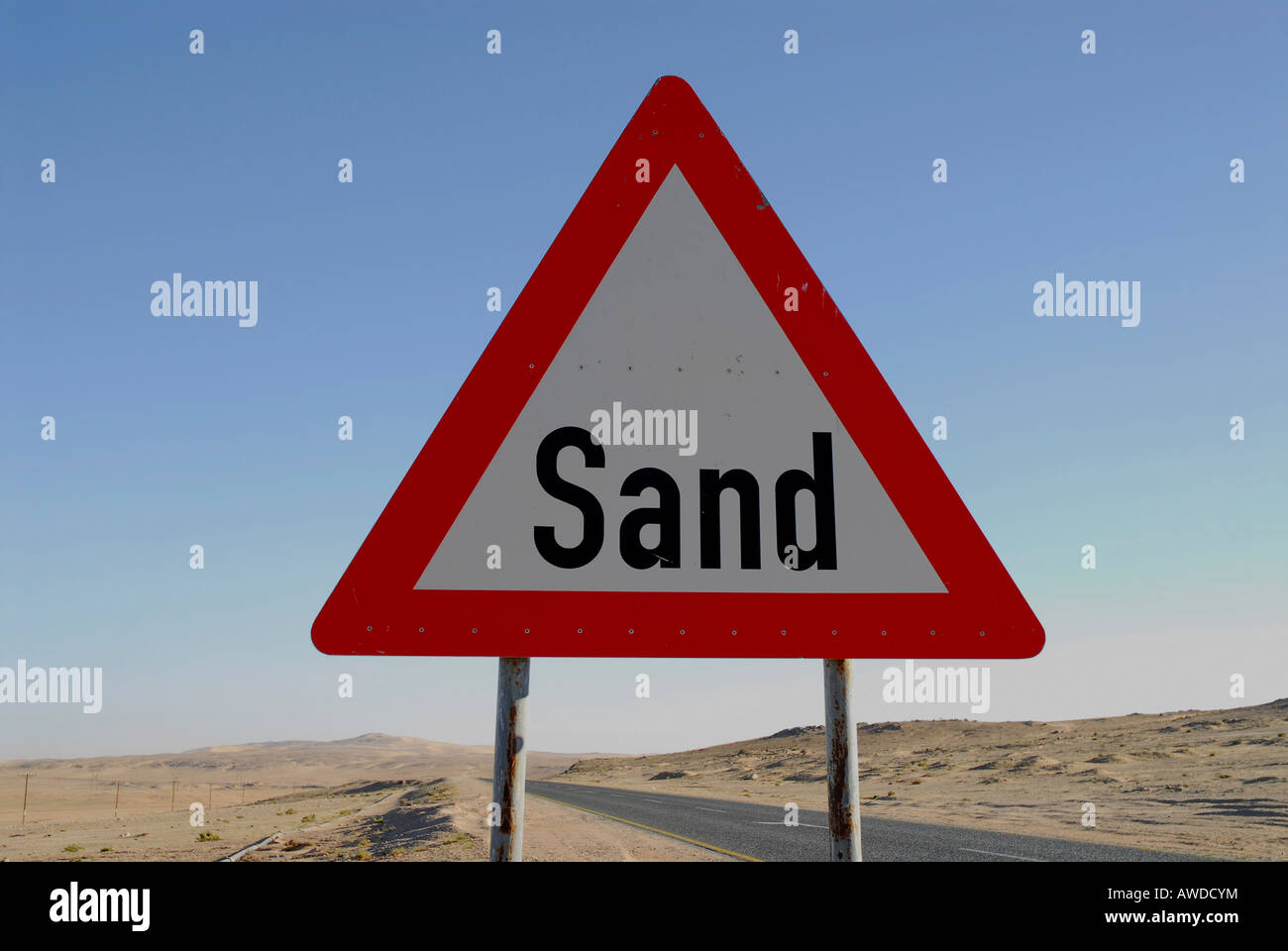 Road sign warning of sweeping sands on a highway near Luederitz, Namibia, Africa - Stock Image