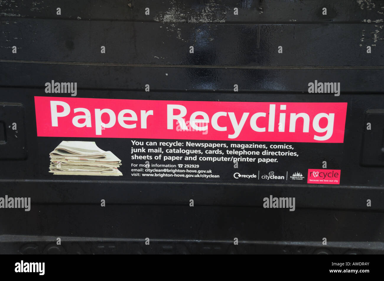 Close up of Paper Recycling Logo on a black recycling bin, England - Stock Image