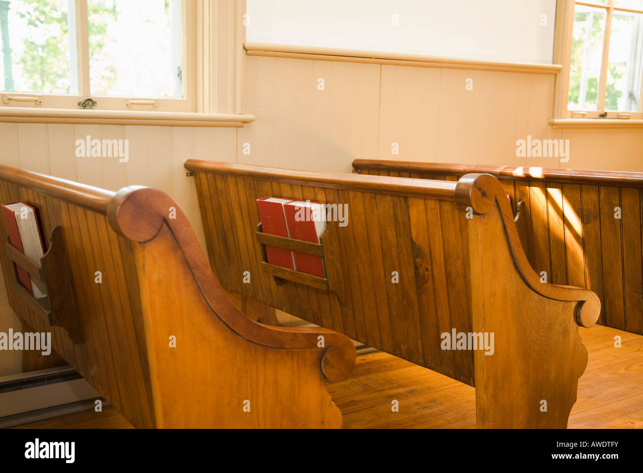 ILLINOIS Rockford Hymnbooks in rack on back of wooden pew historic building Midway Village Community Church - Stock Image