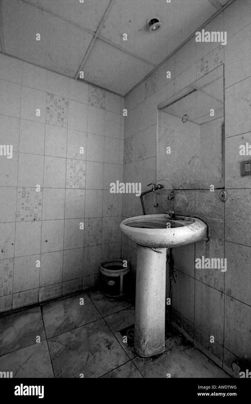 A Dirty Sink In A Public Toilet Black And White